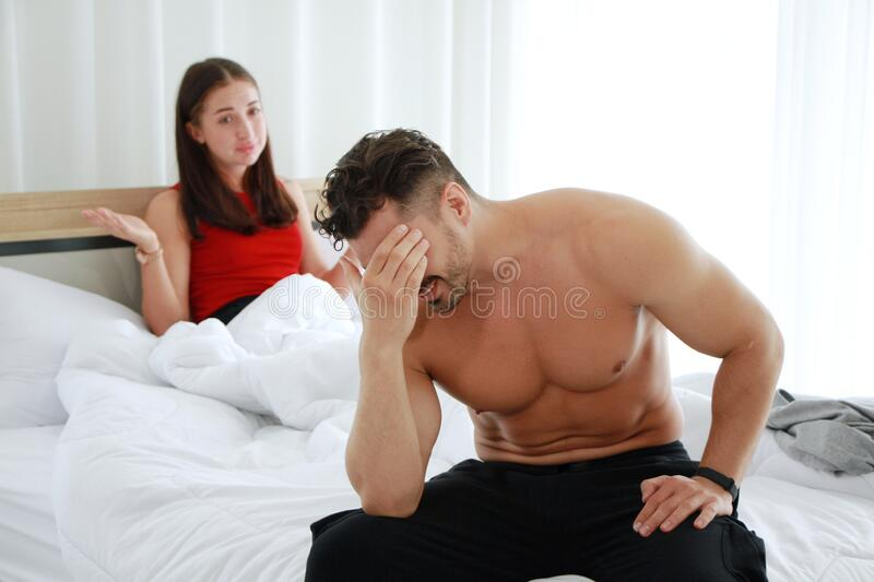 Caucasian lover Couple on the bed unhappy in having sex and have problems in relationship of married life. Erectile Dysfunction. Concept royalty free stock image