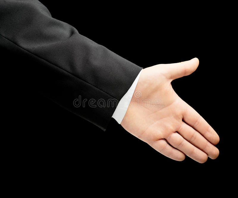 Caucasian male hand in a business suit isolated. Caucasian male hand in a business suit, offering a handshake with an opened palm, low-key lighting composition stock photo