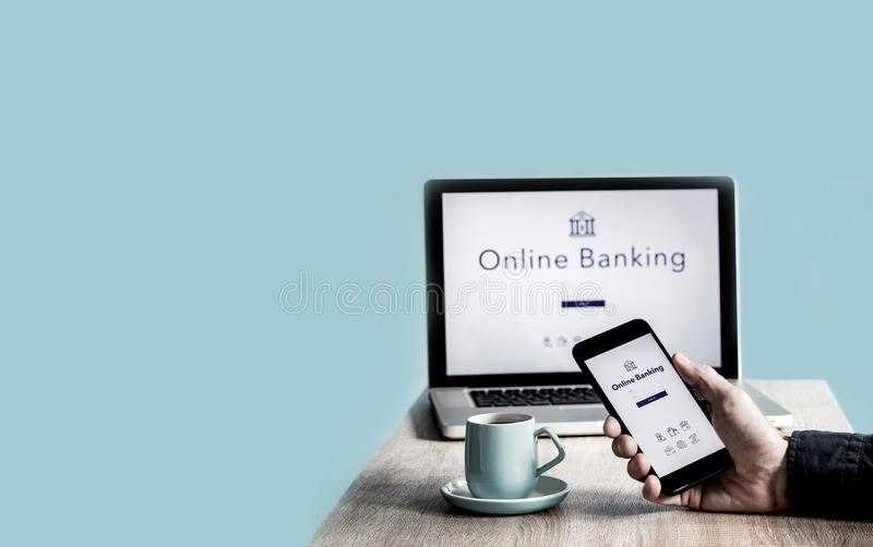 Caucasian Male Hand holding a smartphone with online banking mobile app stock photos