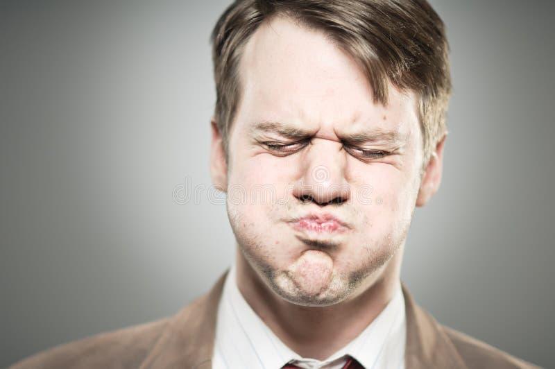 Caucasian Man Blowing Cheeks Expression Portrtait stock image