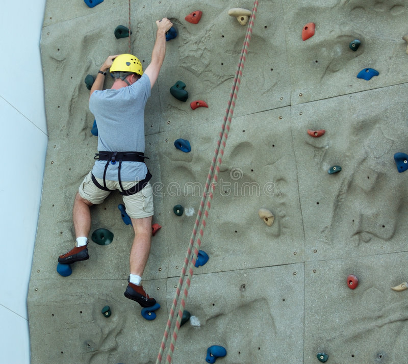 Free Caucasian Man Bouldering With Safety Harness And Helmet Stock Images - 6525574