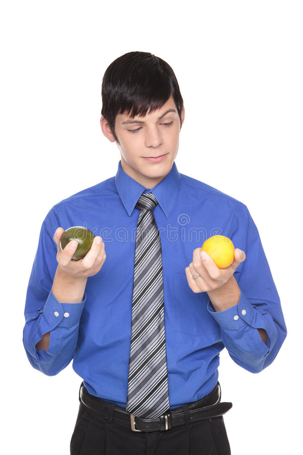 Caucasian man comparing lime to lemon stock photo