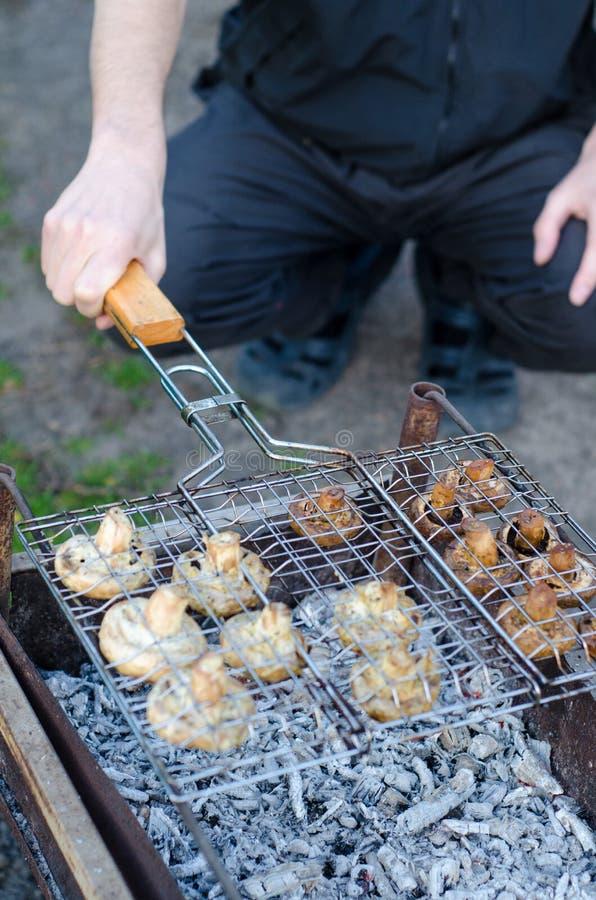 Caucasian Man Cooks Mushrooms Champignon Grill In Grill ...