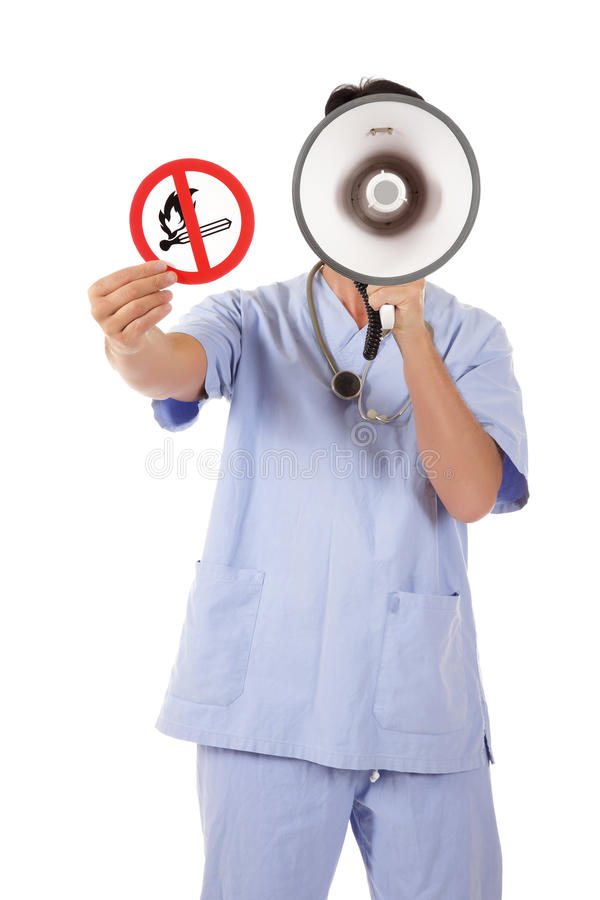 Caucasian man doctor no fire sign. Middle aged caucasian man doctor holding up no fire sign, warning white screaming in megaphone. Studio shot. White background royalty free stock photo