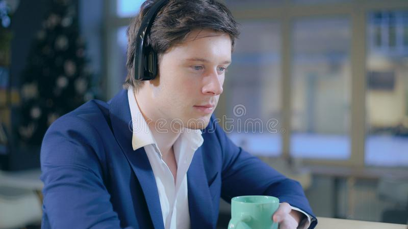 Caucasian man enjoy music indoors. royalty free stock photography