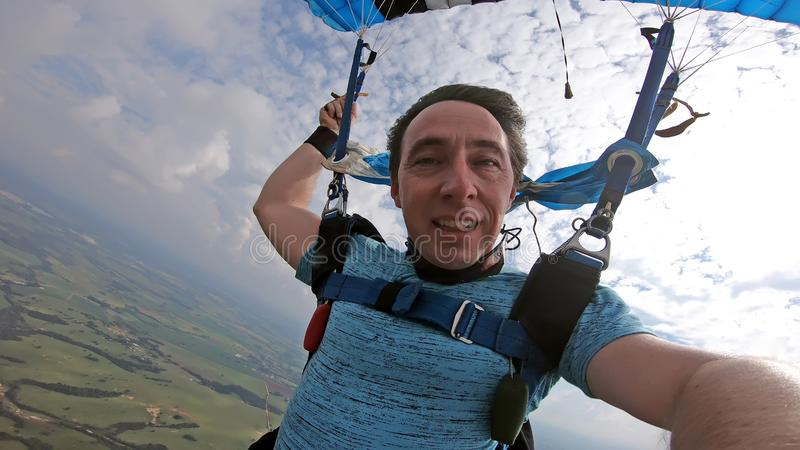 Skydiver making a selfie after the free fall royalty free stock image