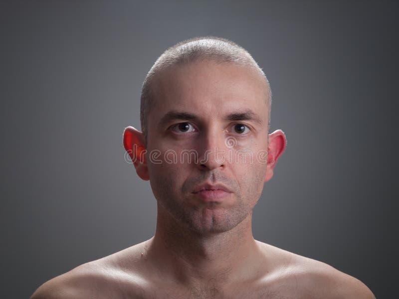 Caucasian man looking at camera stock image