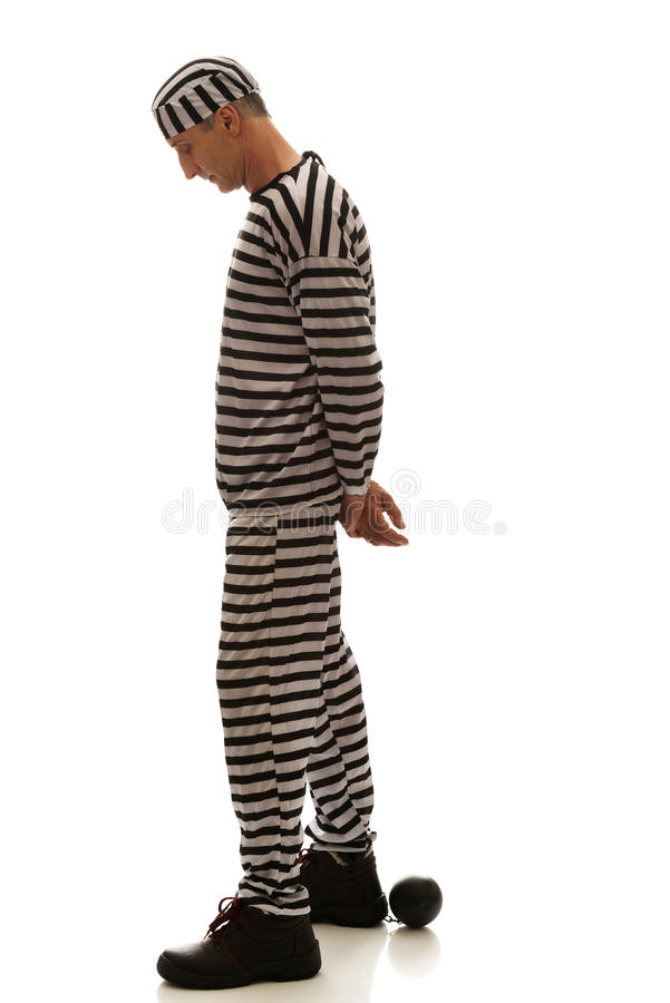 Caucasian man prisoner criminal with chain ball royalty free stock photography