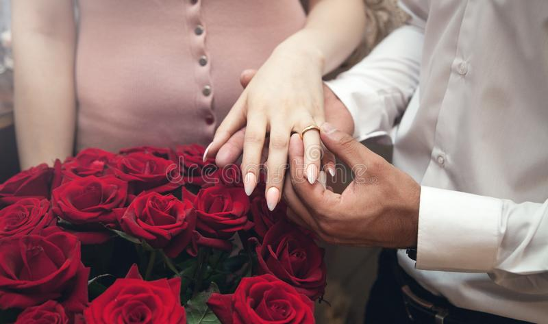 Caucasian man putting on girl finger engagement ring royalty free stock photos