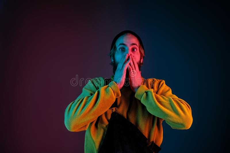 Caucasian man`s portrait isolated on gradient studio background in neon light stock photos