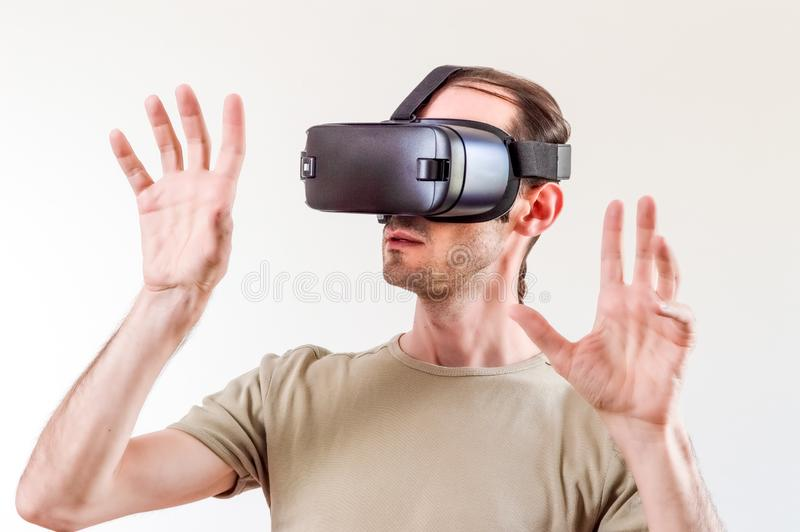 Man exploring modern technology virtual reality with head mounted display on white background royalty free stock photos