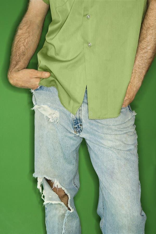 Caucasian man with torn jeans. stock photos