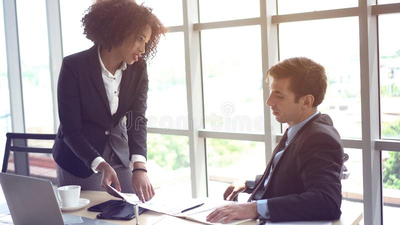 Latino man in trouble having problem with his female boss. Latino men in trouble having problem with his female boss diversity at work stock photos