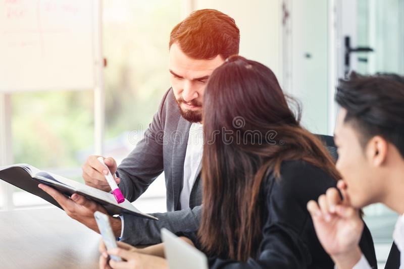 Caucasian manager looking at report and discussion meeting royalty free stock photography