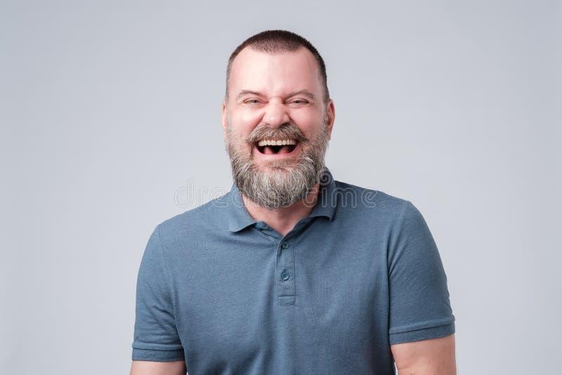 Caucasian mature man laughing on funny joke. royalty free stock images