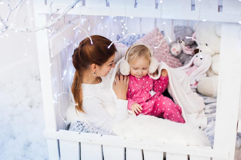 Caucasian mother and daughter in a children`s lodge. royalty free stock photo