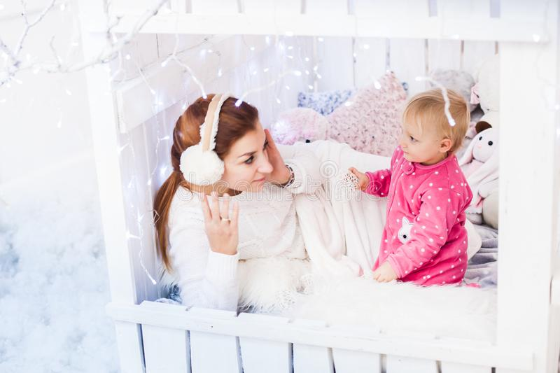 Caucasian mother and daughter in a children`s lodge. stock images