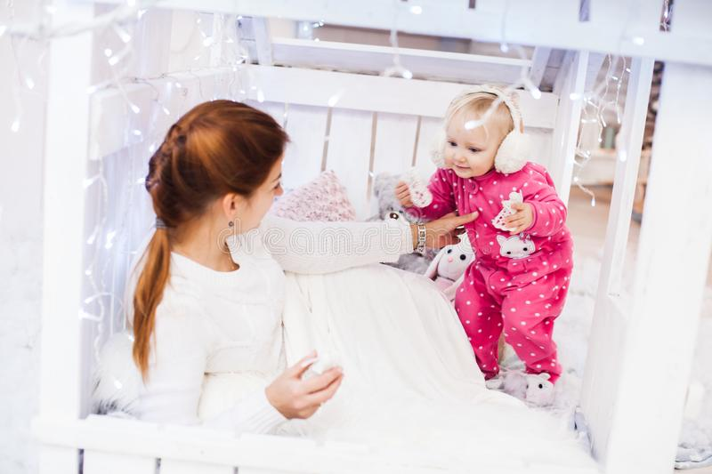 Caucasian mother and daughter in a children`s lodge. stock photography