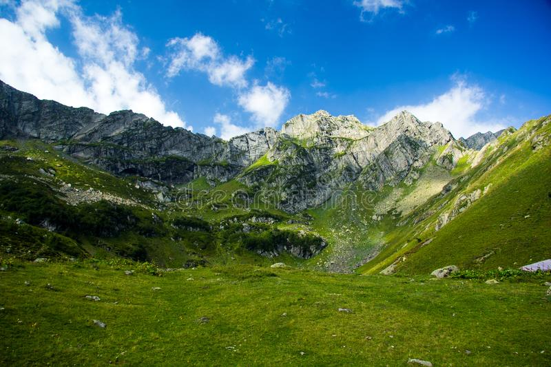 Caucasian Mountain landscape. Alpine meadow and cliffs in summer day royalty free stock image
