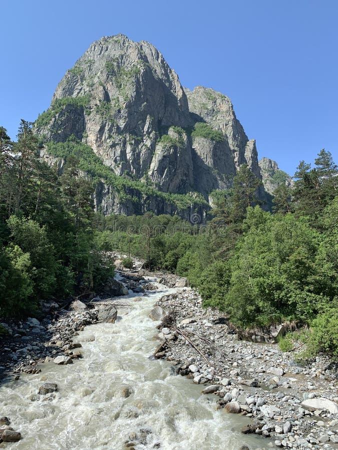 Caucasian mountain landscape. Tsey gorge. The mountain Monk and the river Tseydon. Republic of North Ossetia-Alania, Russia stock photos