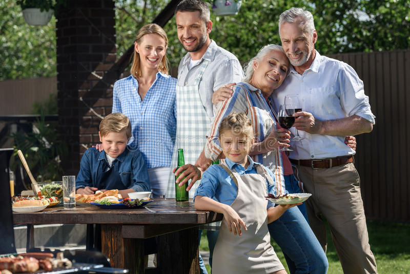 Caucasian multi-generational family having picnic on patio at daytime. Happy caucasian multi-generational family having picnic on patio at daytime royalty free stock images