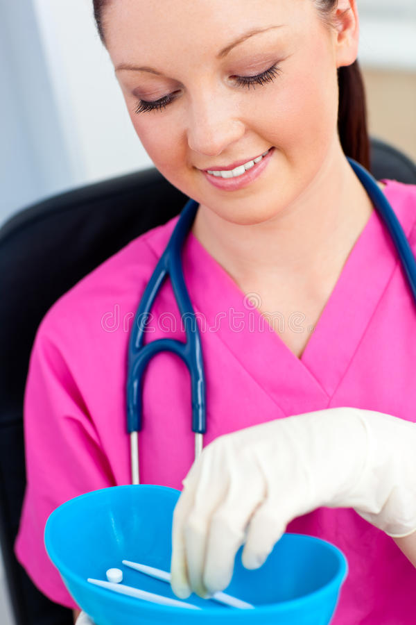 Caucasian nurse holding pills in a hospital royalty free stock image