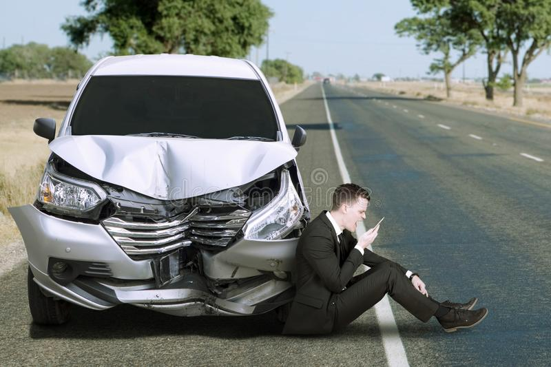 Caucasian person and damaged car stock photos