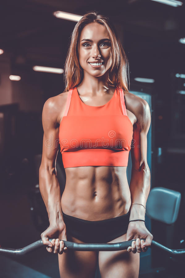 Caucasian pretty fitness girl on diet training pumping up muscle stock image