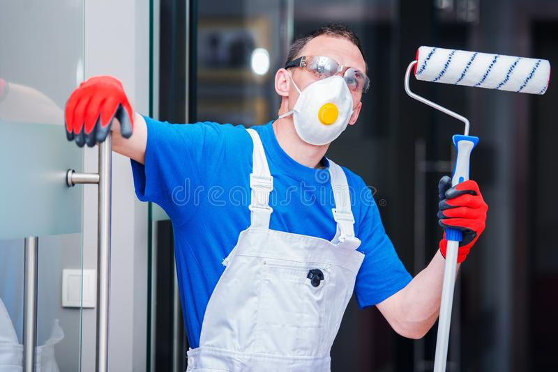 Caucasian Room Painter. With Painting Roller Ready For Work stock images