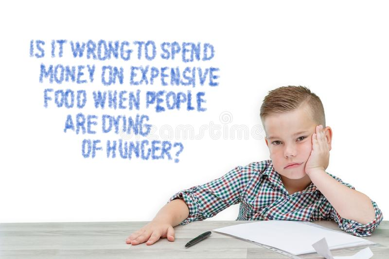Caucasian school-age boy in a plaid shirt thinking about the problems of the world,about whether to buy expensive food when people royalty free stock images