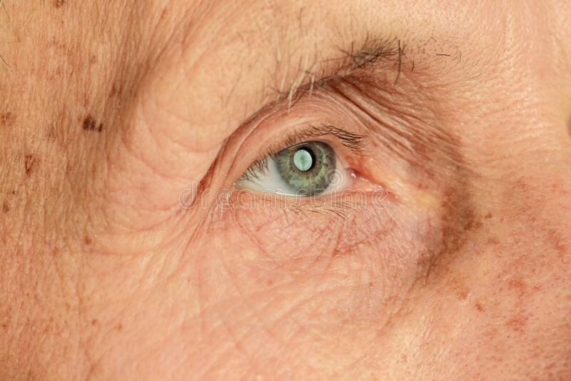 Caucasian senior man`s portrait isolated on yellow studio background stock image