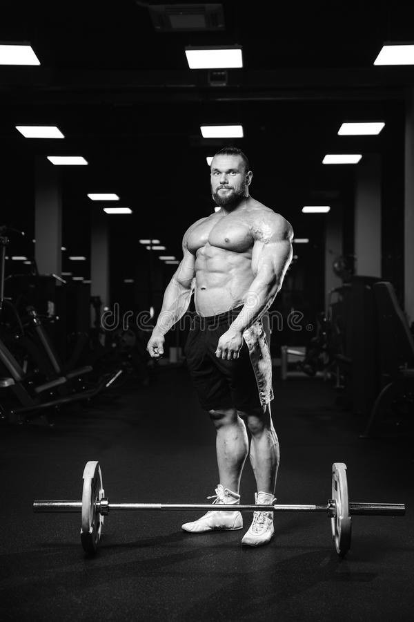Caucasian Fitness Male Model Execute Exercise With Barbell Stock ...