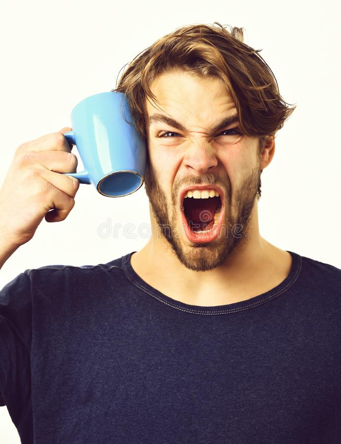 Caucasian sexy young macho holding coffee cup or mug royalty free stock photos