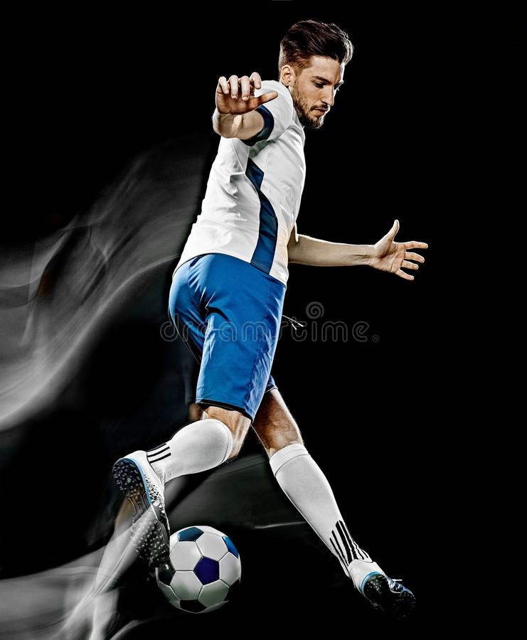 Caucasian soccer player man isolated black background light painting stock images