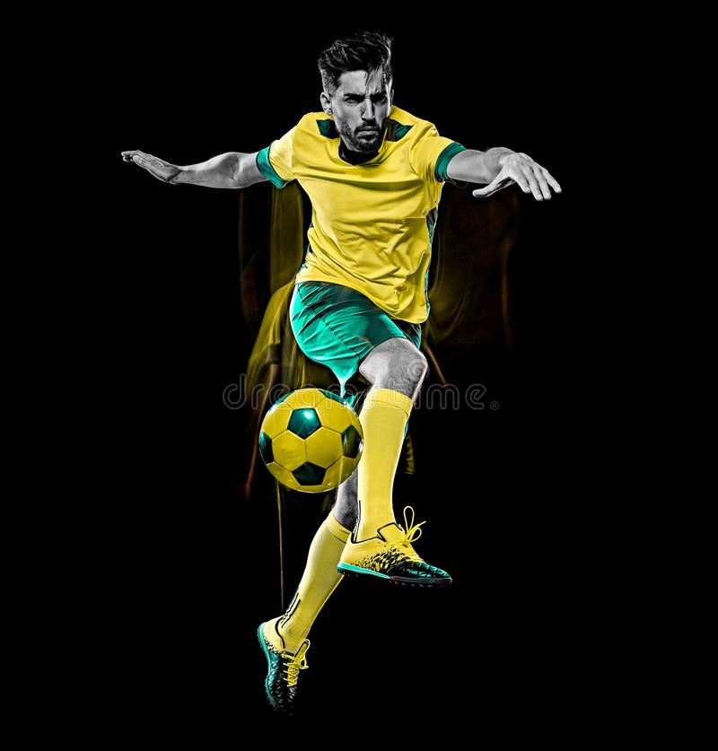 Caucasian soccer player man isolated black background light painting stock photo