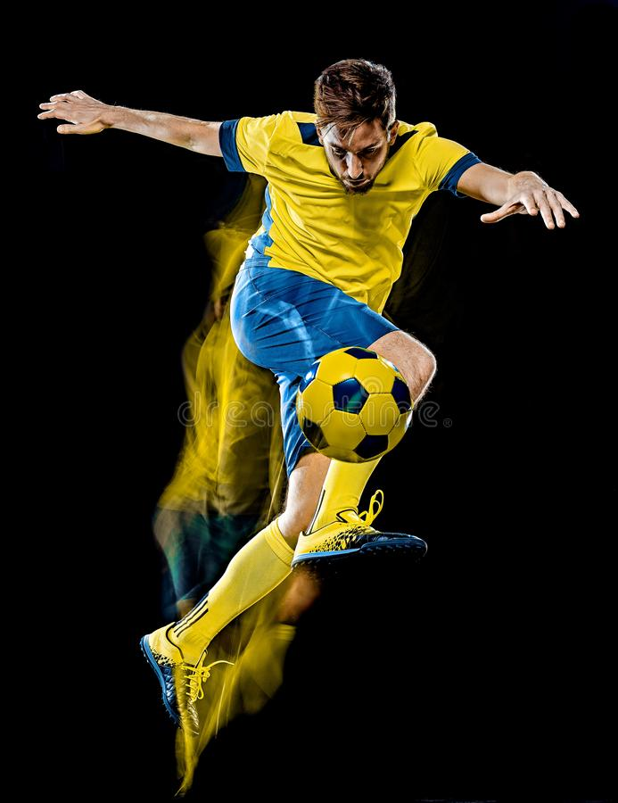 Caucasian soccer player man  black background light painting stock images