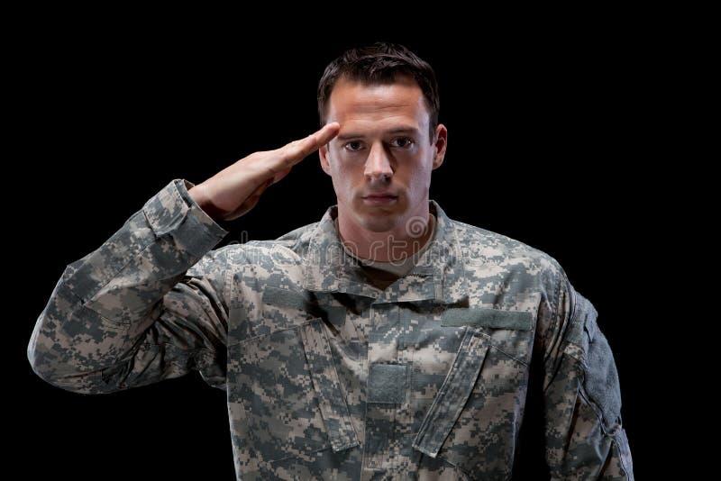 Caucasian soldier salutes stock photos