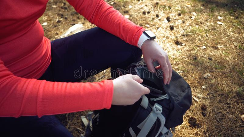 Caucasian sport cyclist woman sport off road bike park near tree. woman athlete in sport clothes and helmet and black stock images