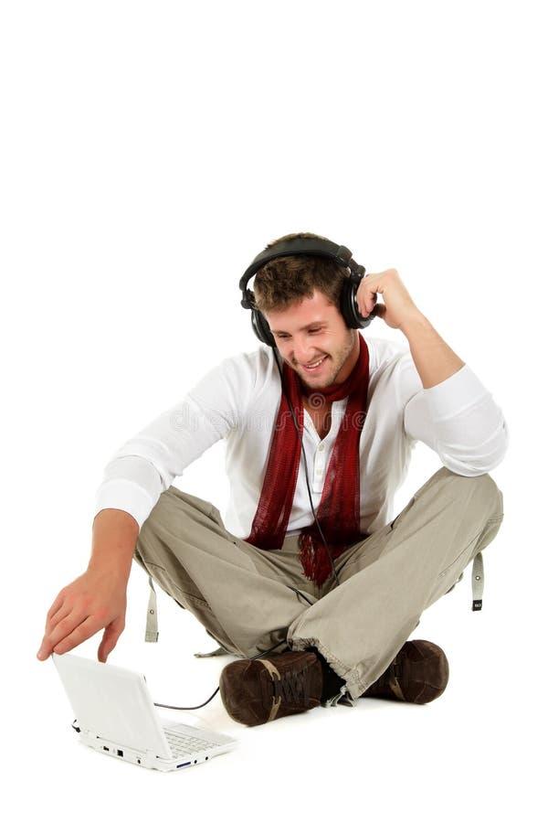 caucasian stiligt lyssnande manmusikbarn royaltyfri fotografi