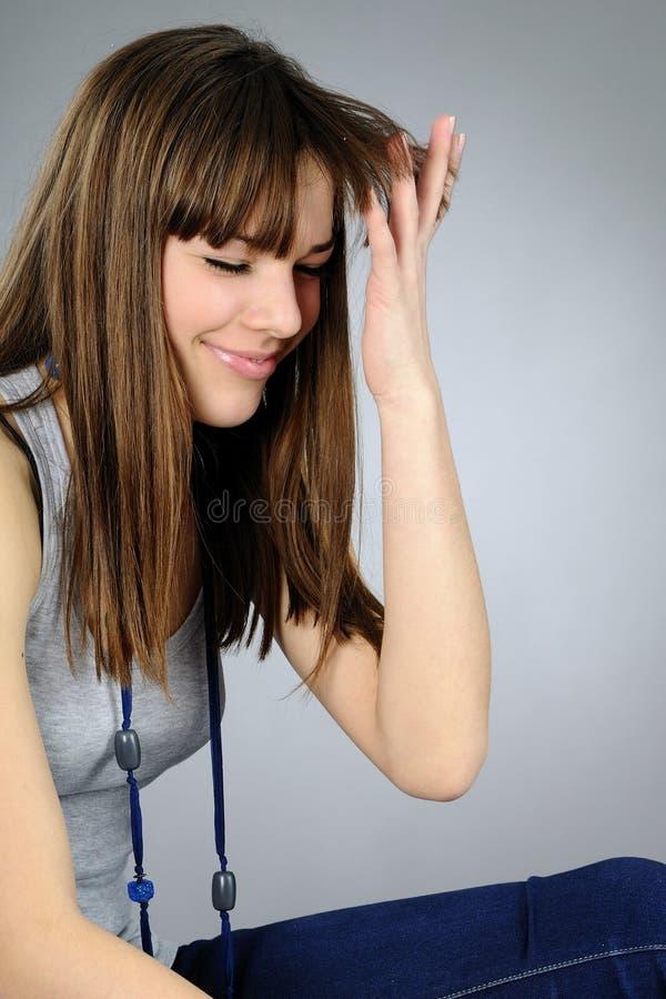 Caucasian teen playing stock photo