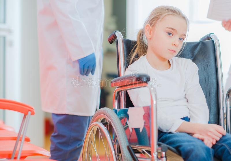 Caucasian Girl on a Wheelchair royalty free stock images