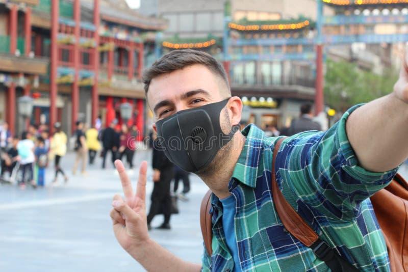 Caucasian tourist using pollution mask in Asia stock photos