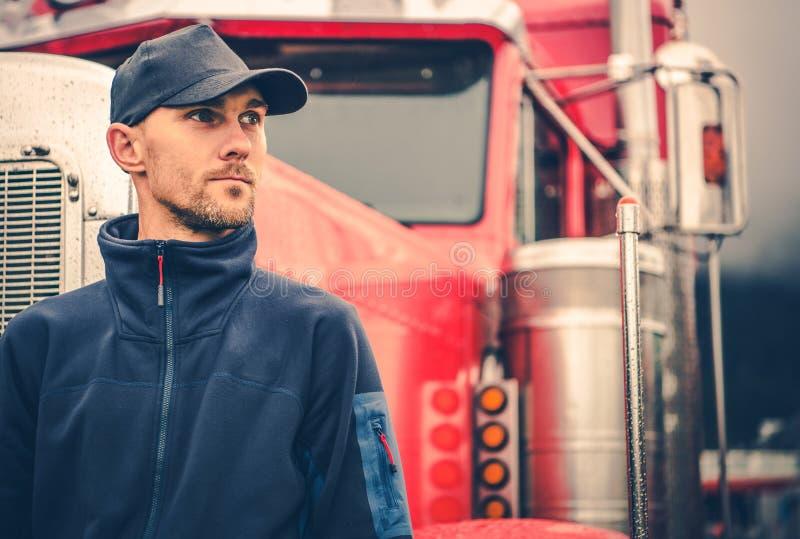 Caucasian Trucker Portrait. Caucasian Trucker in His 30s Portrait. Truck Driving and Logistics Industry stock photos