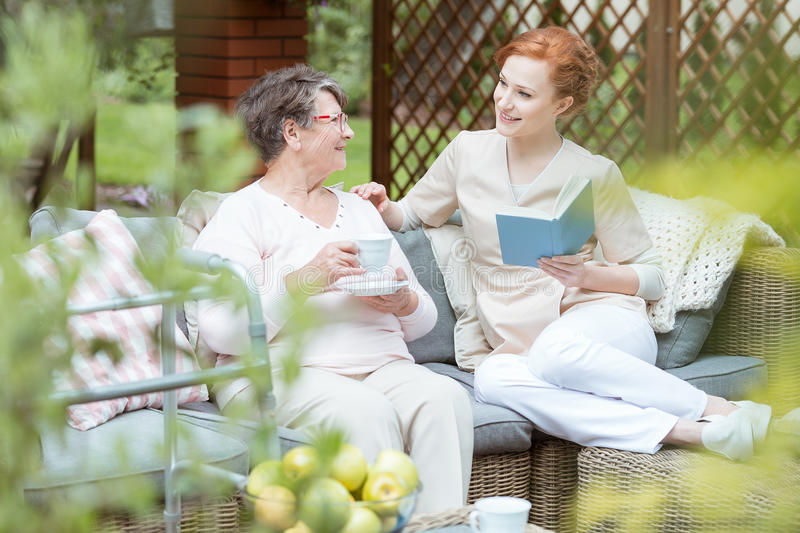 Volunteer spending time with senior royalty free stock images
