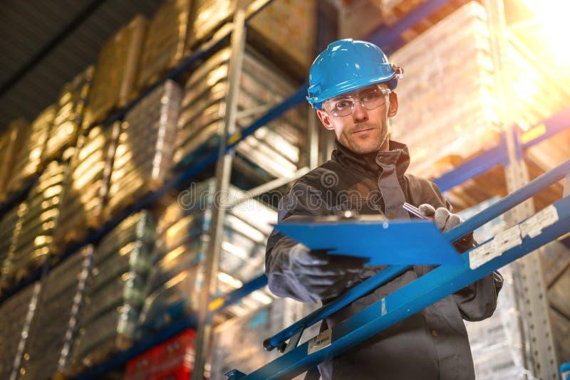 Caucasian warehouse worker giving raports. stock photo