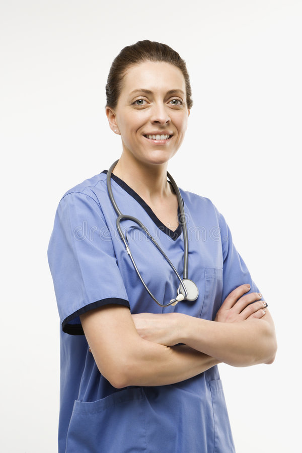 Caucasian woman doctor. Portrait of smiling Caucasian woman doctor standing against white background royalty free stock photo