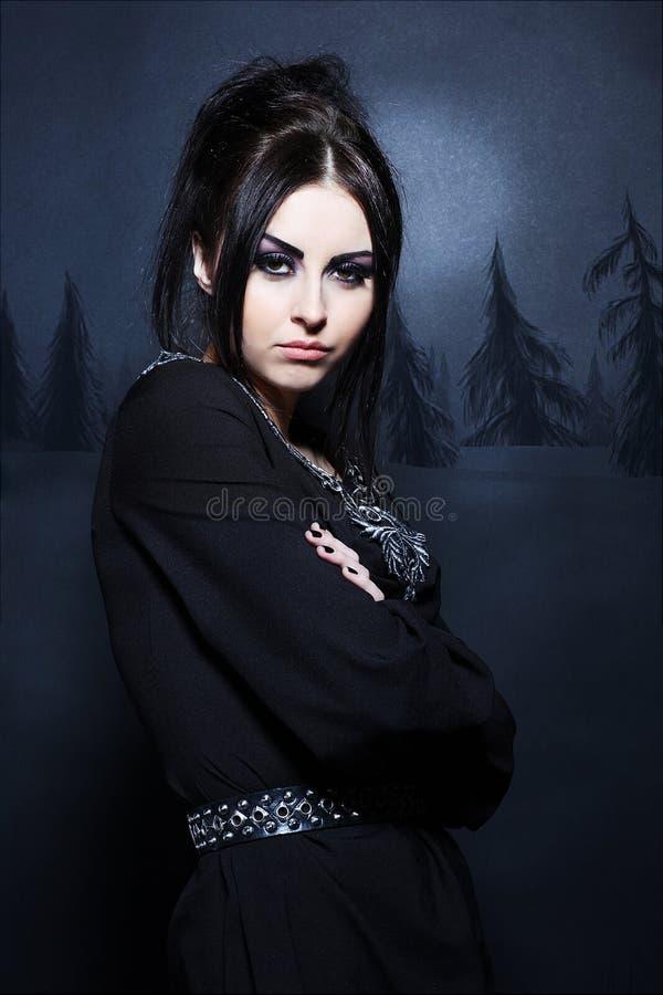 Caucasian woman in an elegant black dress stock photos