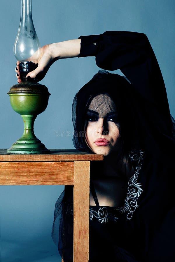 Caucasian woman in an elegant black dress stock photo