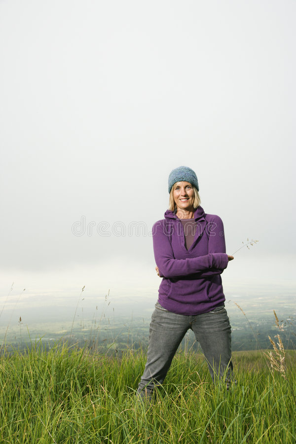 Caucasian woman in field. royalty free stock photos