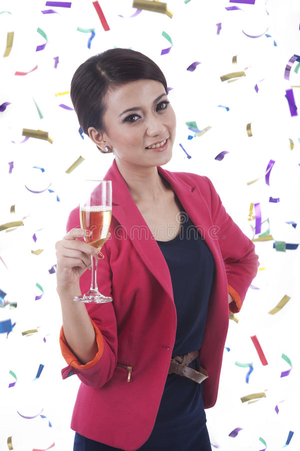 Caucasian Woman with Glass of Champagne. Woman with glass of champagne and confetti around her royalty free stock photo